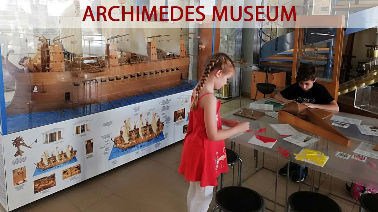 Kids play games of Ancient Greek technology in the Archimedes Museum at Olympia Greece